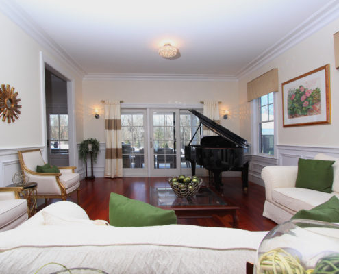 living room with grand piano custom home MA